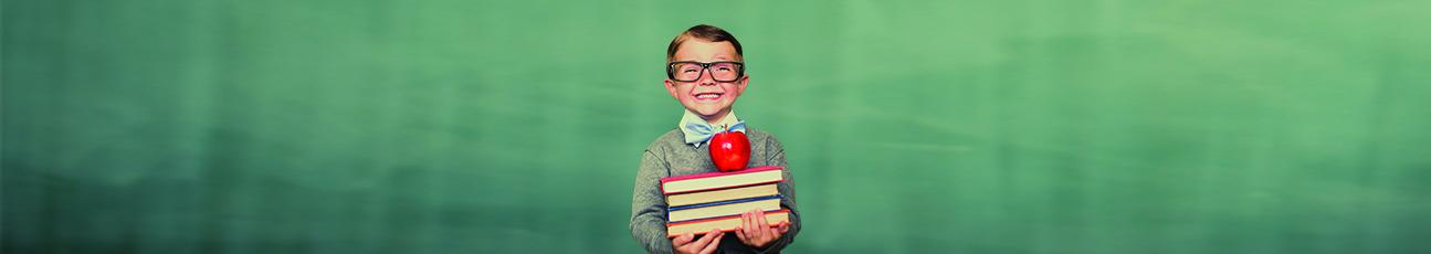 Kid in front of chalk board.jpg